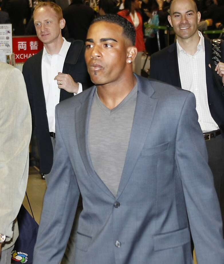 Oakland Athletics outfielder Yoenis Cespedes arrives at Narita International Airport in Narita, east of Tokyo, Friday, March 23, 2012. The Athletics will meet the Seattle Mariners in their two season-opening games of the Major League Baseball in Japan, at Tokyo Dome from Wednesday, March 28. (AP Photo/Koji Sasahara) Photo: Koji Sasahara, Associated Press
