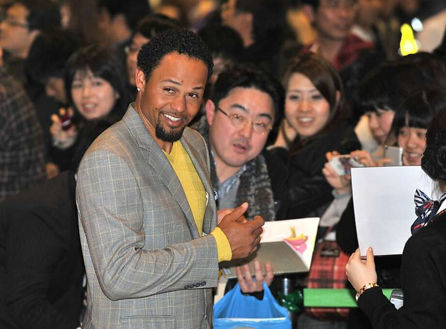 Oakland Athletics outfielder Coco Crisp (L) is welcomed by Japanese fans upon his arrival at Narita airport, Chiba prefecture on March 23, 2012. The Oakland Athletics and Seattle Mariners arrived in Japan ahead of the opening two-game series of the 2012 major league season on March 28-29. AFP PHOTO / KAZUHIRO NOGI (Photo credit should read KAZUHIRO NOGI/AFP/Getty Images) Photo: Kazuhiro Nogi, AFP/Getty Images