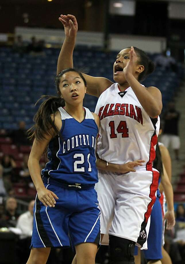 Salesian guard Jackie Lizarraga scores over La Jolla Country Day's Brianne Yasukocki during the girls Division IV CIF State Basketball Championship game in Sacramento, Calif., Friday, March 23, 2012. La Jolla won 72-41 Photo: Lance Iversen, The Chronicle