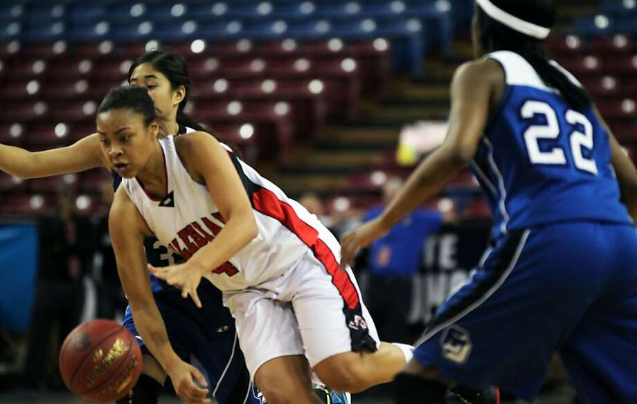 Salesian center Mariya Moore drives to the basket against La Jolla Country Day during the girls Division IV CIF state basketball championship game in Sacramento, Calif., Friday, March 23, 2012. La Jolla won 72-41 Photo: Lance Iversen, The Chronicle