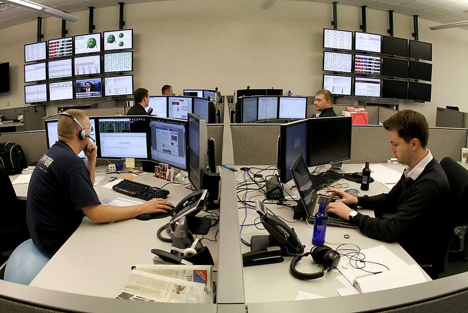 FILE -- Traders work on the floor at BATS Global Markets, the third largest stock exchange system, in Lenexa, Kan., Oct. 8, 2009. Shortly after going public on March 23, 2012, shares of BATS were halted, after a series of technical glitches and system errors that affected trading in Apple and other companies. Several hours later, BATS pulled its public offering, in a rare move for the markets. (Ed Zurga/The New York Times) Photo: Ed Zurga, New York Times