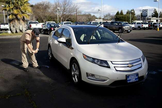 In this file photo, Daniel Gonzales washes a low-emission Chevy Volt at the Novato Chevrolet. Photo: Dania Maxwell, Special To The Chronicle
