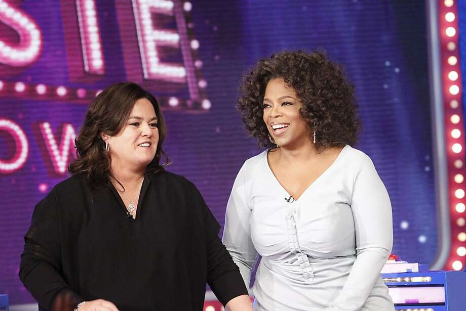 "FILE - In this Oct. 10, 2011 file image released by Harpo, Inc., Oprah Winfrey, right, is shown with host Rosie O'Donnell during the debut of ""The Rosie Show,"" in Chicago. Oprah Winfrey's struggling network, OWN, is laying off 30 workers and restructuring its operations in New York and Los Angeles.  On Friday, March 16,  OWN announced the curtain on ""The Rosie Show"" will be on March 30, after five months on the air. (AP Photo/Harpo, Inc., George Burns/file) Photo: George Burns, Associated Press"