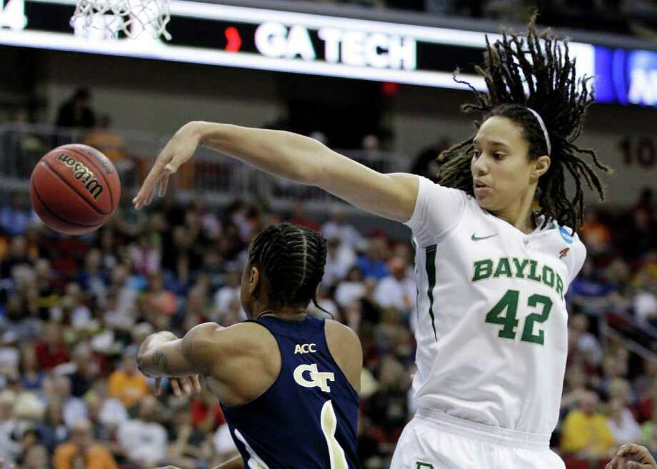 Baylor center Brittney Griner, right, tries to block a shot by Georgia Tech guard Dawnn Maye during the first half of an NCAA women's tournament regional semifinal college basketball game, Saturday, March 24, 2012, in Des Moines, Iowa. (AP Photo/Charlie Neibergall) Photo: Charlie Neibergall, Associated Press / AP