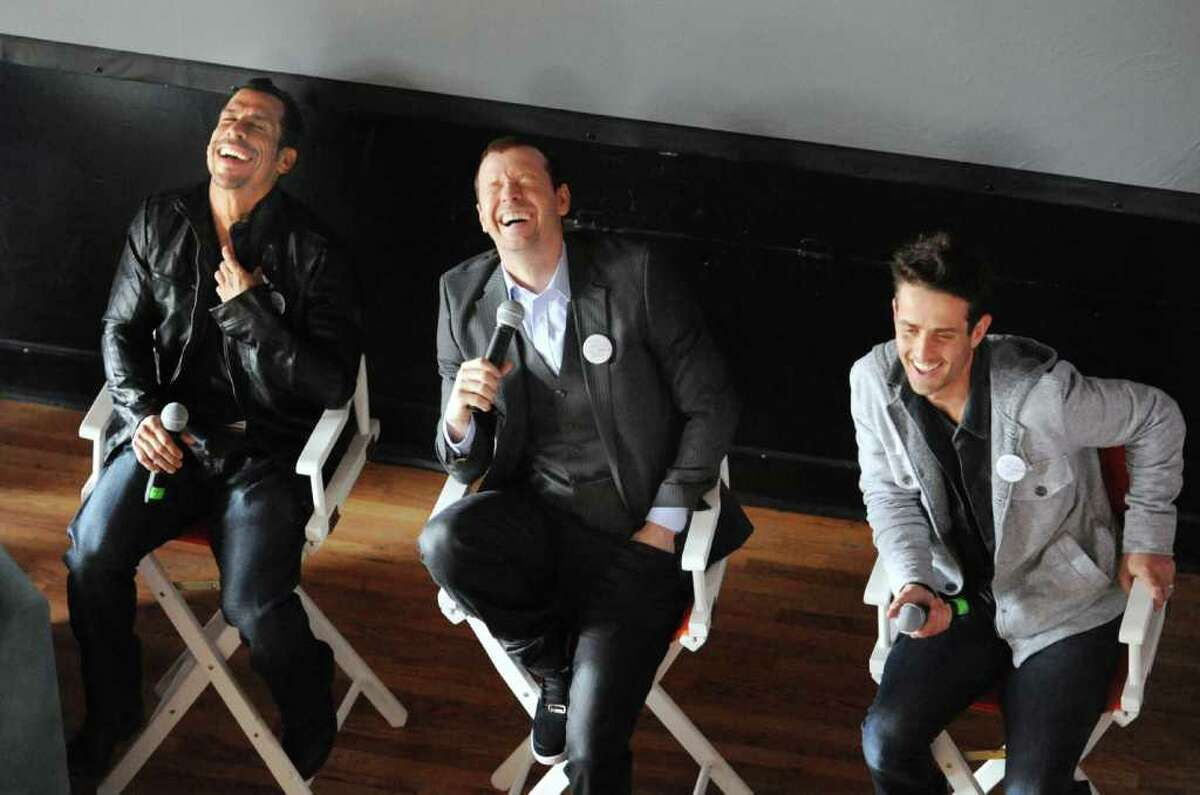 From left, Danny Wood, Donnie Wahlberg and Joey McIntyre, members of New Kids on the Block, the boy band that enjoyed their greatest success in the late 1980s and early 1990s, enjoy a laugh while visiting with members of their fan club Saturday, March 24, 2012, at the Arch Street teen center in Greenwich.