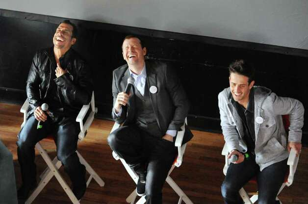 From left, Danny Wood, Donnie Wahlberg and Joey McIntyre, members of New Kids on the Block, the boy band that enjoyed their greatest success in the late 1980s and early 1990s, enjoy a laugh while visiting with members of their fan club Saturday, March 24, 2012, at the Arch Street teen center in Greenwich. Photo: Bob Luckey / Greenwich Time