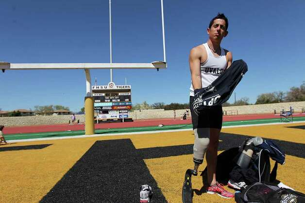 Paralympic Games hopeful James Ortiz prepares to run the 400-meter dash in order to qualify for the U.S. trials competition during the 2012 Alex Francis Classic track and field meet at Fort Hays State University in Hays, Kansas on Saturday, Mar. 24, 2012. Ortiz, who lost a portion of his right leg in an accident in 2006, needed 70 seconds to qualify. He completed the race in 58.36.  Kin Man Hui/Express-News. Photo: KIN MAN HUI, Kin Man Hui/Express-News / ©2012 San Antonio Express-News