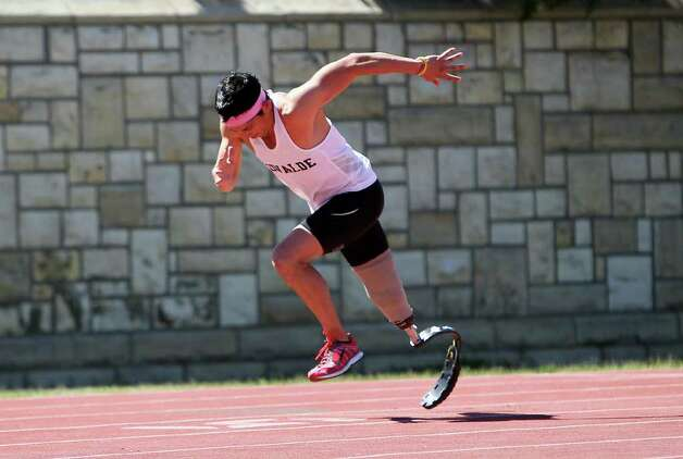 Paralympic Games hopeful James Ortiz leaps from the starting line as he runs the 400-meter dash in order to qualify for the U.S. trials competition during the 2012 Alex Francis Classic track and field meet at Fort Hays State University in Hays, Kansas on Saturday, Mar. 24, 2012. Ortiz, who lost a portion of his right leg in an accident in 2006, needed 70 seconds to qualify. He completed the race in 58.36.  Kin Man Hui/Express-News. Photo: KIN MAN HUI, Kin Man Hui/Express-News / ©2012 San Antonio Express-News