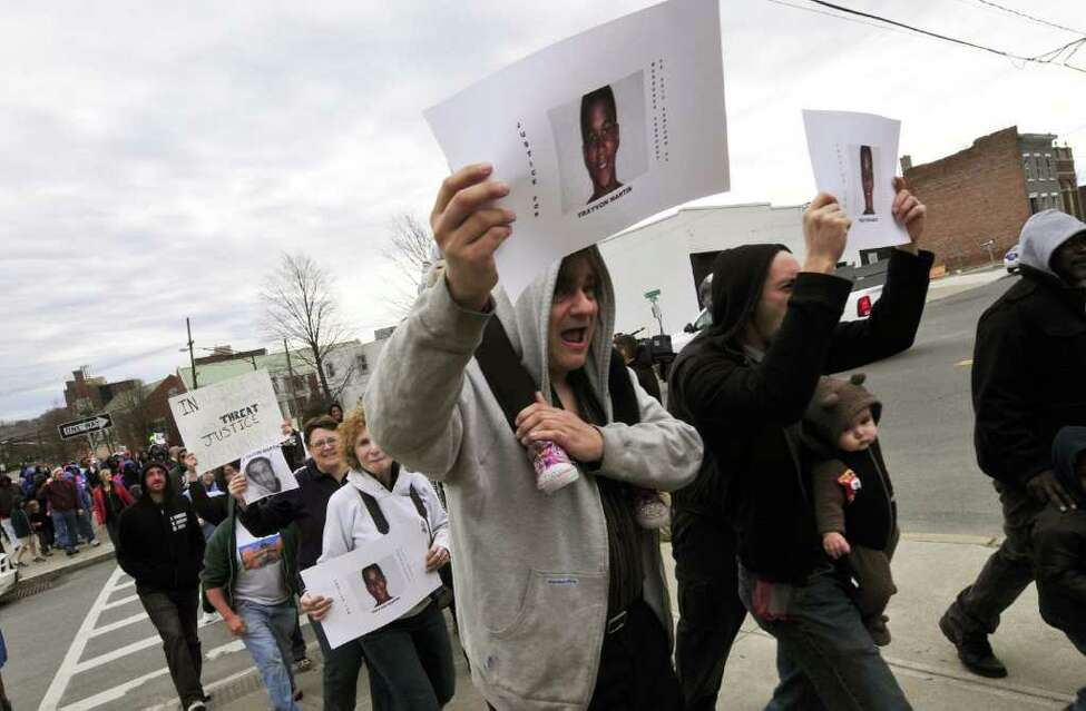 Marchers chant and make their way up Morton Avenue during the