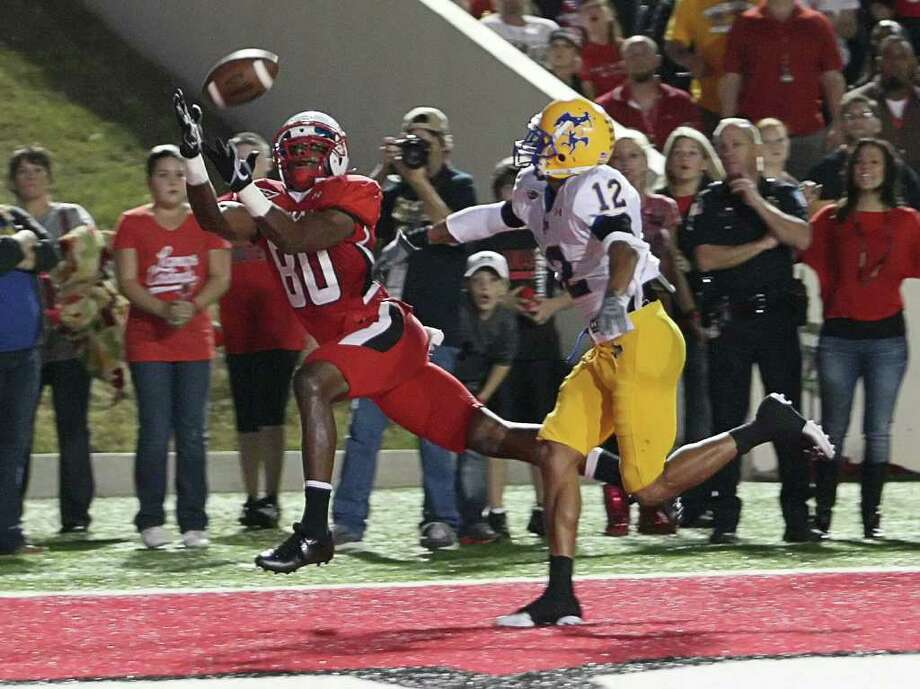 Lamar's J.J. Hayes catches a touchdown during the first quarter of Lamar's game against McNeese State Saturday at Provost Umphrey Stadium. Photo: Matt Billiot