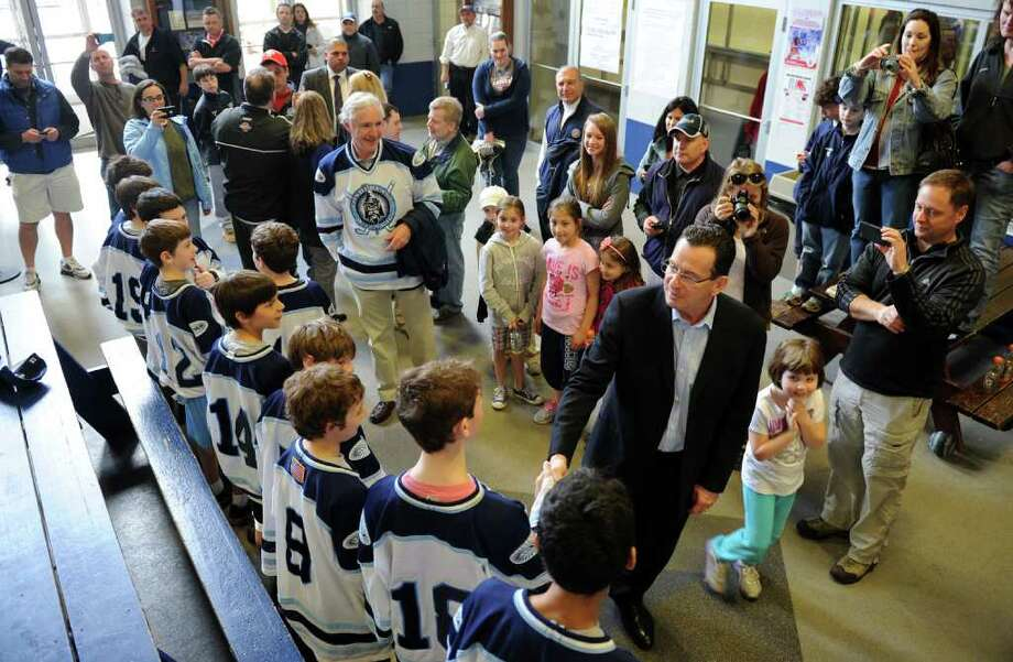 Governor Malloy greets members of the Wonderland Wizard Youth hockey team at the Wonderland of Ice in Bridgeport, Conn. on Saturday March 24, 2012. There are three teams that will be going to the national hockey finals. Photo: Christian Abraham / Connecticut Post