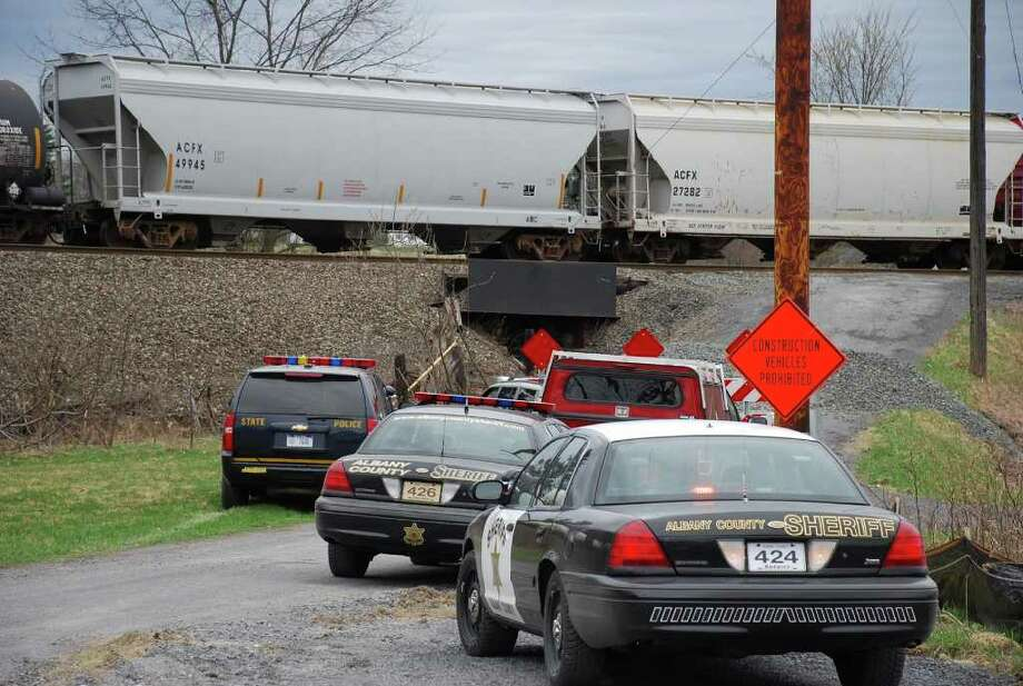 Law enforcement officials respond to a train-pedestrian accident at Youmans Road in New Scotland on Saturday, March 24, 2012. (Thomas Heffernan Sr. / Special to the Times Union) Photo: Picasa