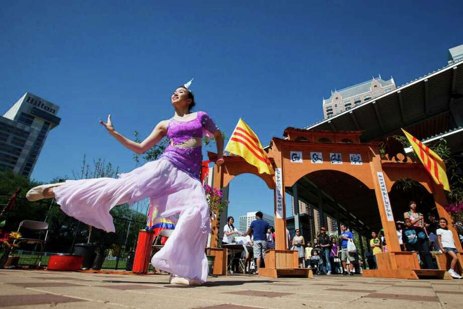 "Thy Nguyen, 19, performs a traditional Vietnamese dance titled ""Fish in the Sea"" during the Hope Initiative's 2012 Vietnamese Festival in honor of Vua Hùng (Hùng kings), founders of Vietnam, at Discovery Green, Saturday, March 24, 2012, in Houston. The Vietnamese Festival aims to promote unity within the Vietnamese community while introducing Vietnamese culture to communities in the Greater Houston area. Photo: Michael Paulsen, Houston Chronicle / © 2012 Houston Chronicle"