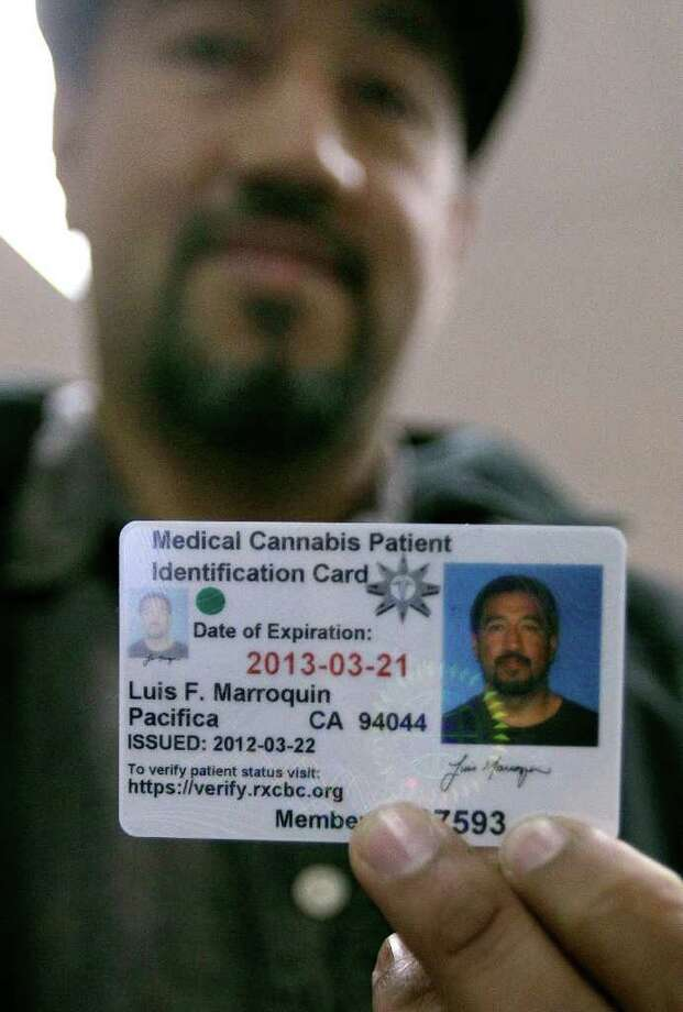Luis Marroquin holds up his renewed medical cannabis patient identification card at the Patient ID Center in Oakland, Calif., Thursday, March 22, 2012. California has seven times as many residents as Colorado, but nearly nine times fewer medical marijuana users, at least on paper. And as far as record-keepers know, the most populous state, home to the nation's first and most liberal medical marijuana laws, also has a smaller number of pot patients than Arizona, Hawaii, Michigan, Montana and Oregon. (AP Photo/Jeff Chiu) Photo: Jeff Chiu