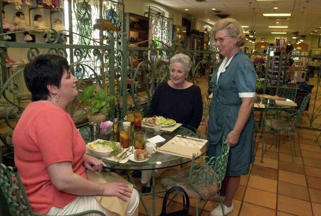 BIZ: Waitress Patty Wiley (rt.) chats with customers Allison Hicks (L) and Jacque Mangold at the restaurant in Scriveners retail store Monday. Scrivener's is being purchased by the Houston-based company Bering's, Inc. Staff photo By: John Davenport Photo: JOHN DAVENPORT, JD / EN