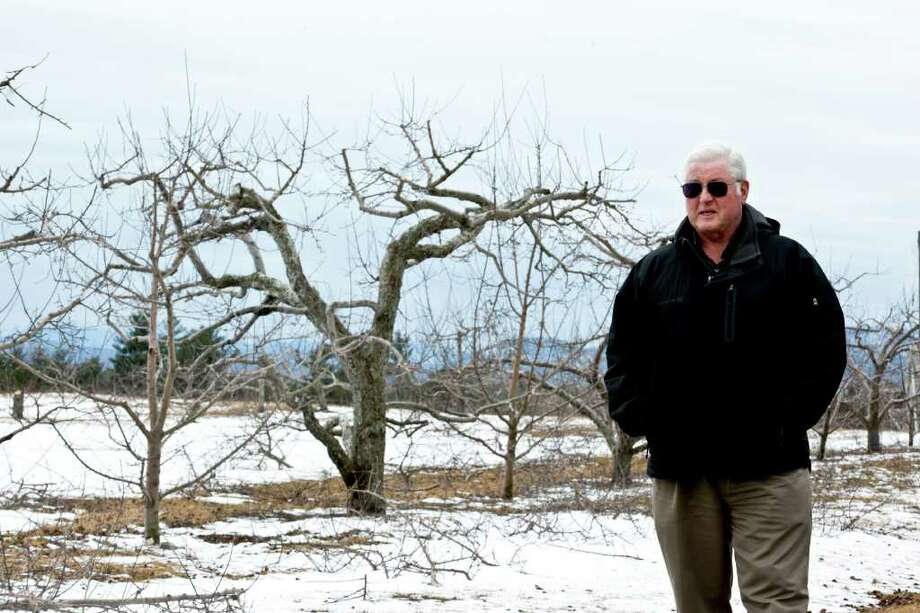 Peter Glushko, town supervisor in Peru, N.Y., tours Rulfs Orchard, which has been hit hard by a feral pig infestation. They are a growing threat to New York. Photo: NANCIE BATTAGLIA / NYTNS