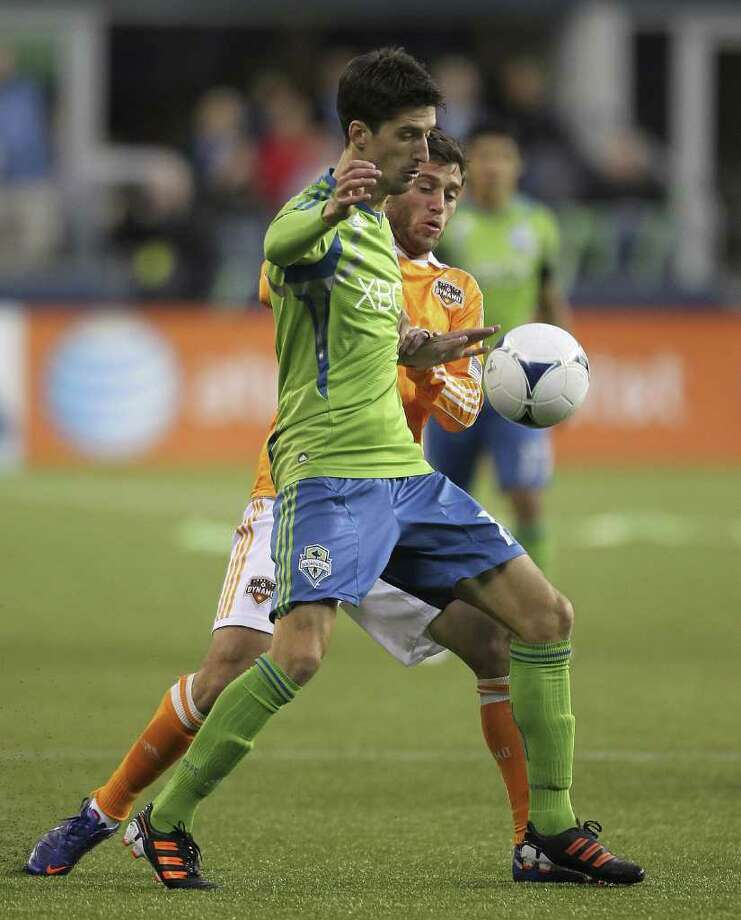 Alvaro Fernandez of the Seattle Sounders battles Colin Clark of the Houston Dynamo at CenturyLink Field on March 23, 2012 in Seattle. Photo: Otto Greule Jr, Getty Images / 2012 Getty Images
