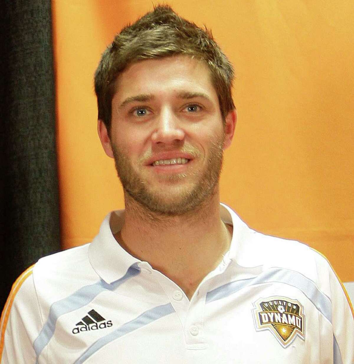 The Dynamo midfielder Colin Clark during a press conference announcing the signing of several players Friday, Dec. 17, 2010, in Houston.