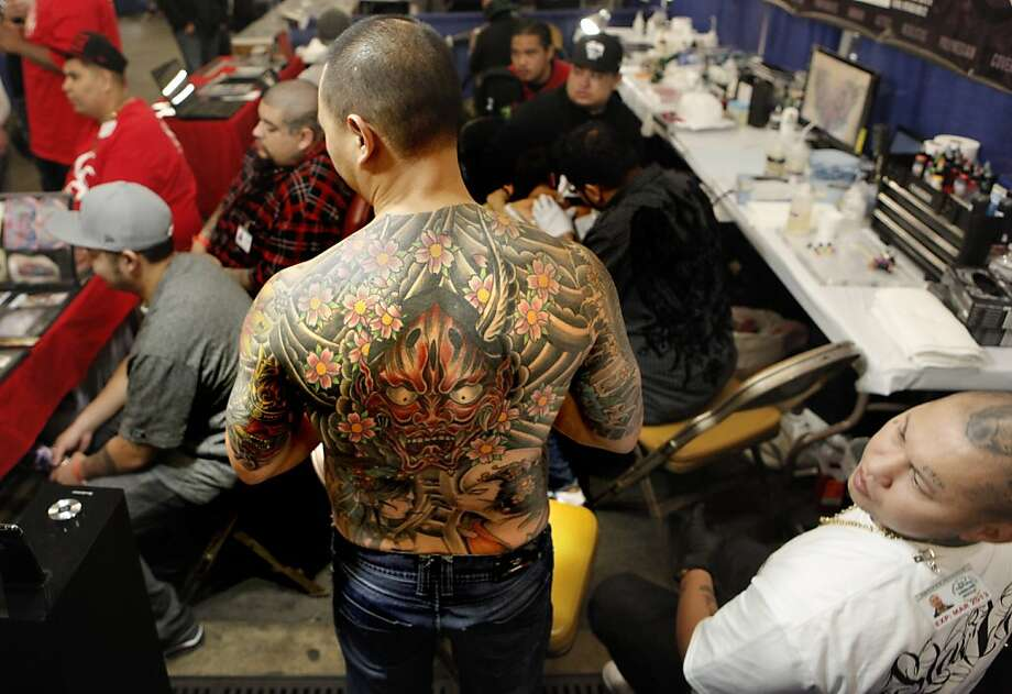Richard Tio, prepares to get a touch up on his creation by artist Nes Andrion, (right) of  Stain Tattoo, located in Las Vegas, during the Body Art Expo at the Cow Palace on Saturday March 24, 2012, in San Francisco, Ca. Photo: Michael Macor, The Chronicle