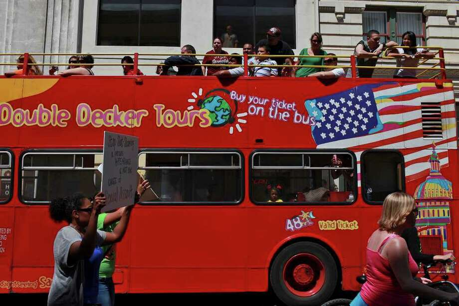 OK, so we may not have the cool red photo booths but we do have red double decker tour buses which you can catch downtown in Alamo Plaza to tour the city. Check 'em out.  Photo: LISA KRANTZ, SAN ANTONIO EXPRESS-NEWS / SAN ANTONIO EXPRESS-NEWS