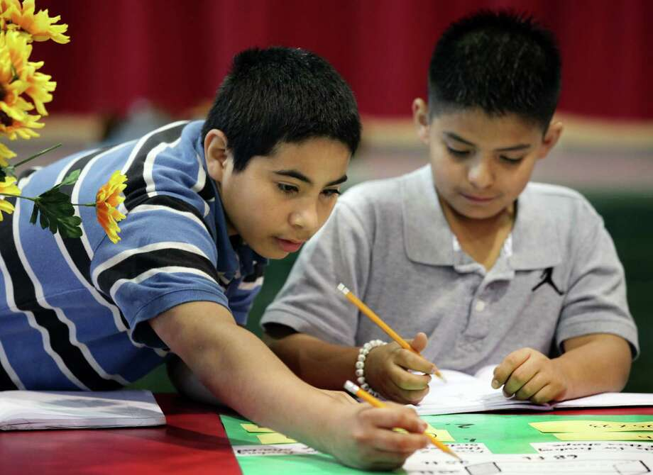 """Armando Rivera, left, and Dylan Rodriguez work at a math station at Hopkins Elementary School's """"Math Dash"""", as they move through stations performing math problems preparing for the new STAAR testing program. Friday, March 23, 2012. Bob Owen/San Antonio Express-News. Photo: BOB OWEN, San Antonio Express-News / © 2012 San Antonio Express-News"""