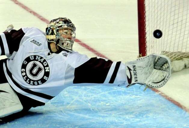 Union goalie #1 Troy Grosenick sretches out to make a save, during NCAA Men's Ice Hockey Bridgeport Regional against UMASS Lowell at the Webster Bank Arena in Bridgeport, Conn. on Saturday March 24, 2012. Photo: Christian Abraham / Connecticut Post