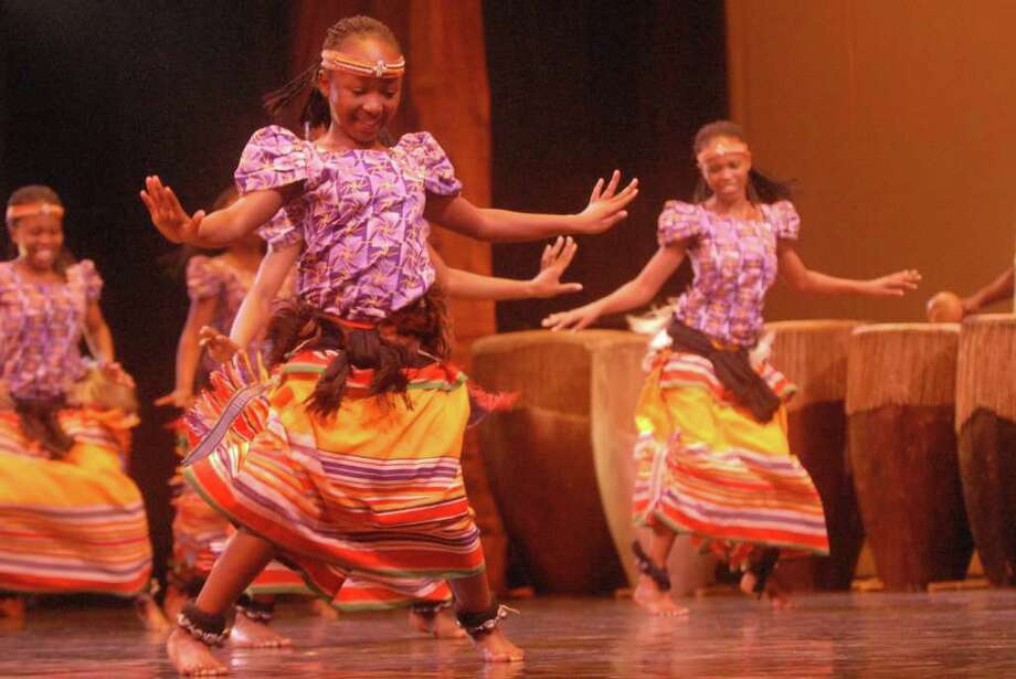 "Spirit of Uganda performs ""Bakisimba"" at the Egg on Friday, March 23, 2012. The group consists of 22 young performers from Uganda. (Yi-Ke Peng / Times Union) Photo: Yi-Ke Peng"