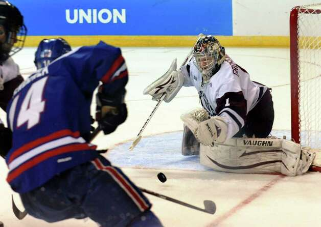 Union goalie #1 Troy Grosenick goes to block a goal attempt by UMASS Lowell's #14 Joseph Pendenza, left, during NCAA Men's Ice Hockey Bridgeport Regional at the Webster Bank Arena in Bridgeport, Conn. on Saturday March 24, 2012. Photo: Christian Abraham / Connecticut Post