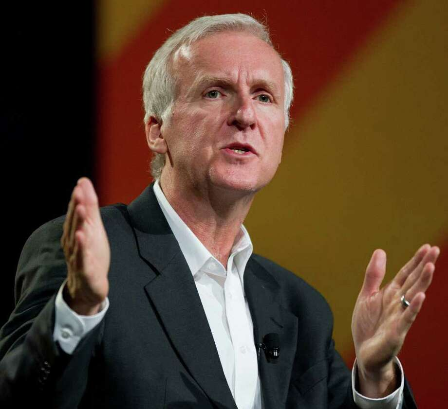 """FILE - In this April 11, 2011 file photo, director James Cameron speaks at the National Association of Broadcasters convention in Las Vegas. Cameron tells National Geographic News that his specially designed submarine called """"Deepsea Challenger"""" completed the nearly 7-mile test dive Wednesday March 22, 2012. The team returned to calmer waters and was headed back to the site Saturday. (AP Photo/Julie Jacobson, file) Photo: Julie Jacobson / AP2011"""