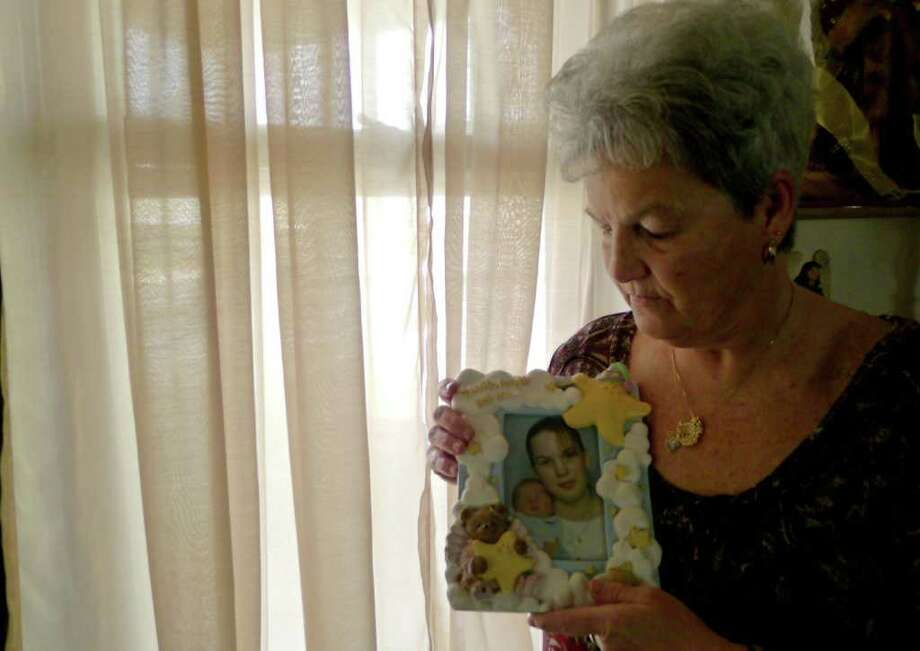 Nathalie Evans holds a photograph of her daughter Wendy Ann Butterworth at her home in Menands, N.Y., Thursday March 15, 2012. Wendy Ann Butterworth committed suicide in November of 2005. (Michael P. Farrell/Times Union ) Photo: Michael P. Farrell / 00016817A