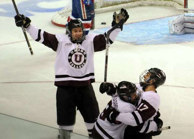 Union's #17 Daniel Cianpini, at right, celebrates with teammates after scoring a goal against UMASS Lowell, during NCAA Men's Ice Hockey Bridgeport Regional at the Webster Bank Arena in Bridgeport, Conn. on Saturday March 24, 2012. Photo: Christian Abraham / Connecticut Post