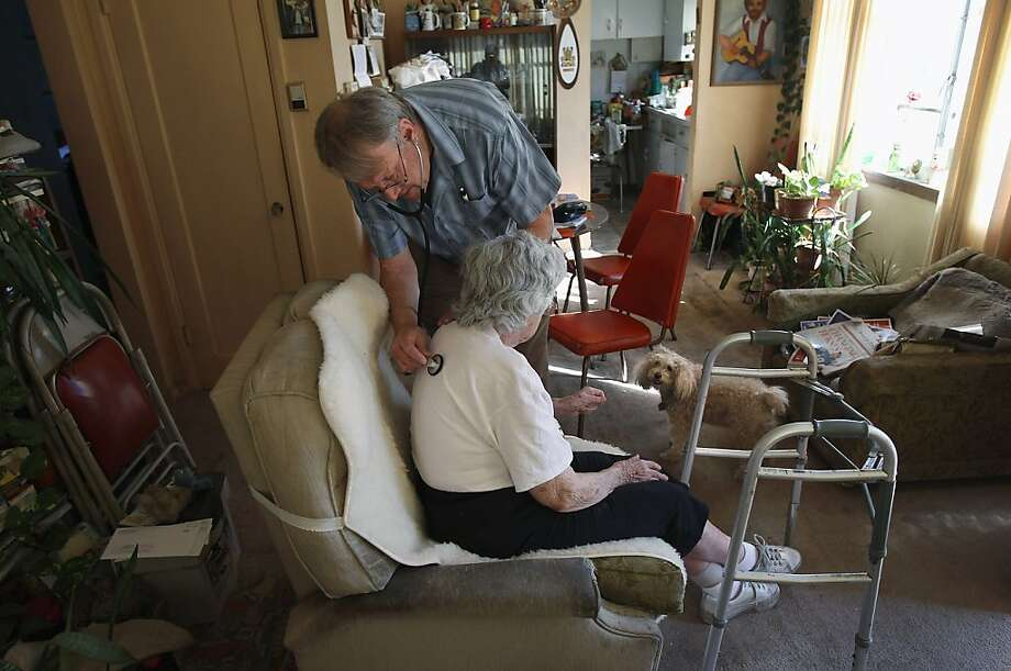 DENVER, CO - MARCH 23:  Registered nurse Steve Van Dyke monitors Mildred Herman's breathing while on a home health care visit on March 23, 2012 in Denver, Colorado. Van Dyke works for the Dominican Sisters Home Health Agency, a non-profit that performs thousands of home visits each year in the Denver area. The agency provides home health care without charge to patients with chronic diseases and provides preventative health care that is often not covered by Medicare. The Supreme Court will hear oral arguments next week on whether the 2010 health law can require most Americans to have health insurance starting in 2014.  (Photo by John Moore/Getty Images) Photo: John Moore, Getty Images