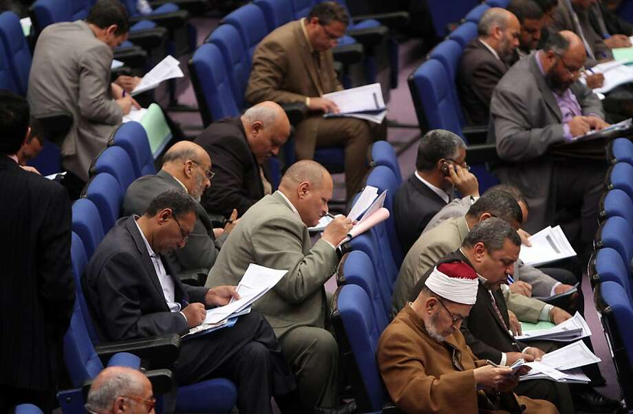 Members of Egypt's parliament attend a conference on March 24, 2012, to vote for a panel that will draft the first constitution since the uprising that toppled president Hosni Mubarak in February 2011. The liberals accused the majority Islamists of trying to monopolise the 100-member panel, whose constitution will replace the one annulled by the ruling military. AFP PHOTO / STR . (Photo credit should read -/AFP/Getty Images) Photo: -, AFP/Getty Images