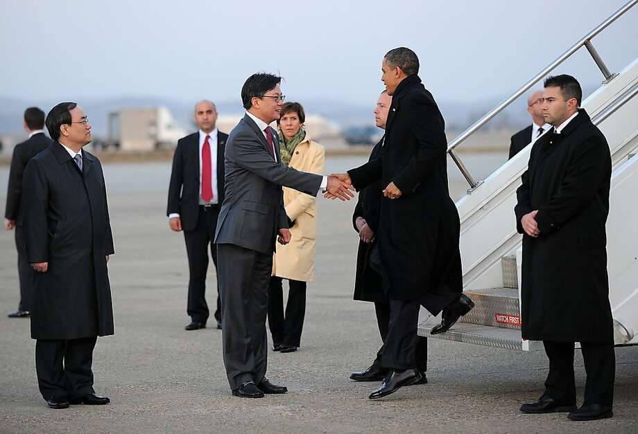 US President Barack Obama is greeted by US ambassador Sung Kim (C) as he disembarks from Air Force One at Osan Air Base in Pyongtaek, some 64 kilometers (40 miles) south of Seoul, on March 25, 2012. Obama arrived in South Korea to attend the 2012 Seoul Nuclear Security Summit to be held on March 26-27. Photo: Jewel Samad, AFP/Getty Images