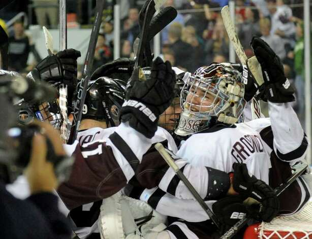 Union teammates celebrate with goalie #1 Troy Grosenick after the team defeated UMASS Lowell 4-2, during NCAA Men's Ice Hockey Bridgeport Regional action at the Webster Bank Arena in Bridgeport, Conn. on Saturday March 24, 2012. Photo: Christian Abraham / Connecticut Post