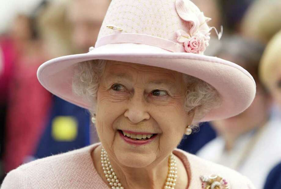 Britain's Queen Elizabeth II, who was in Manchester, England, for the opening of a hospital on Friday, also found time to drop by a wedding in the area to give the newlyweds royal good wishes. Photo: HEATHCLIFF O'MALLEY / Copyright ©Heathcliff O'Malley , All Rights Reserved, not to be published in any format without prior permission from copyright