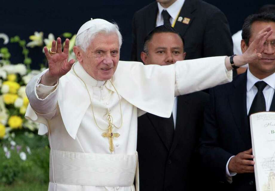 Pope Benedict XVI  waves during the symbolic key ceremony of the city of Guanajuato, Mexico, Saturday March 24, 2012. Benedict arrived in Mexico Friday afternoon, a decade after the late Pope John Paul II's last visit. The pontiff's weeklong trip to Mexico and then to Cuba on Monday is his first to both countries. Photo: AP