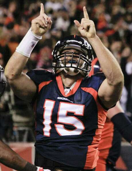 FILE - In this Nov. 17, 2011 file photo, Denver Broncos quarterback Tim Tebow reacts after scoring a touchdown in the fourth quarter against the New York Jets in an NFL football game, in Denver. Tebow was traded Wednesday, March 21, 2012,  to the New York Jets.  (AP Photo/Barry Gutierrez, File) Photo: Barry Gutierrez / Associated Press