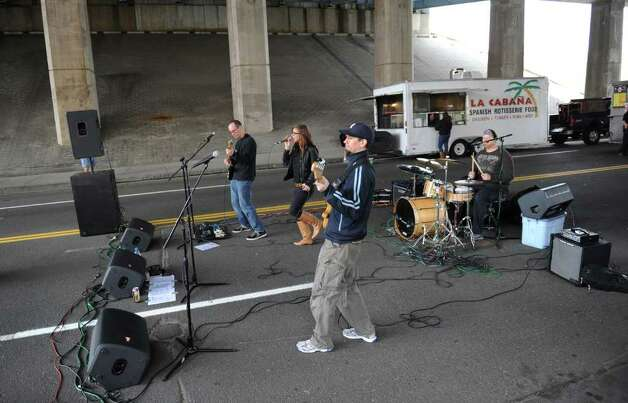 A rock band performs outside prior to NCAA Men's Ice Hockey Bridgeport Regional action between Union and UMASS Lowell at the Webster Bank Arena in Bridgeport, Conn. on Saturday March 24, 2012. Photo: Christian Abraham / Connecticut Post