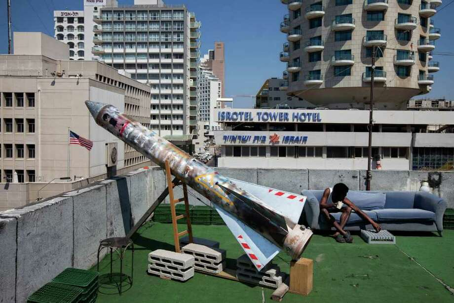"In this image made on Thursday, March 22, 2012, a model of a rocket is displayed on a roof next to the U.S. embassy as part of an art exhibition called ""Iran"" at a gallery in Tel Aviv, Israel. Israelis have mounted an art exhibition centered on Iran, built a web site in Farsi to provide news of Israeli society and daily life, and later Saturday plan to protest possible plans to bomb Iranian nuclear installations.  (AP Photo/Oded Balilty) Photo: Oded Balilty / AP"