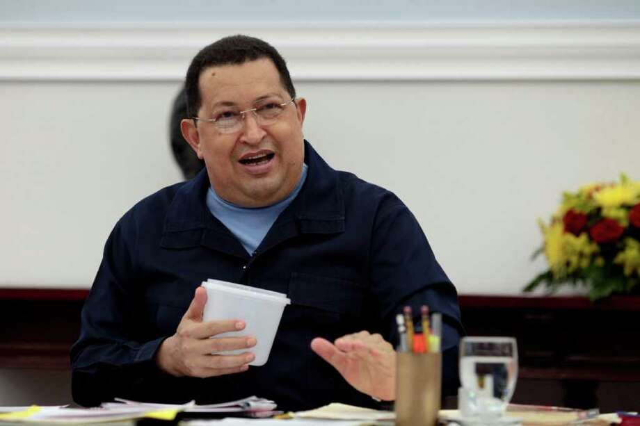 Venezuelan President Hugo Chavez tells officials Saturday that he will be getting  radiation therapy. Photo: MIGUEL ANGEL ANGUL / Copyright: Prensa Miraflores