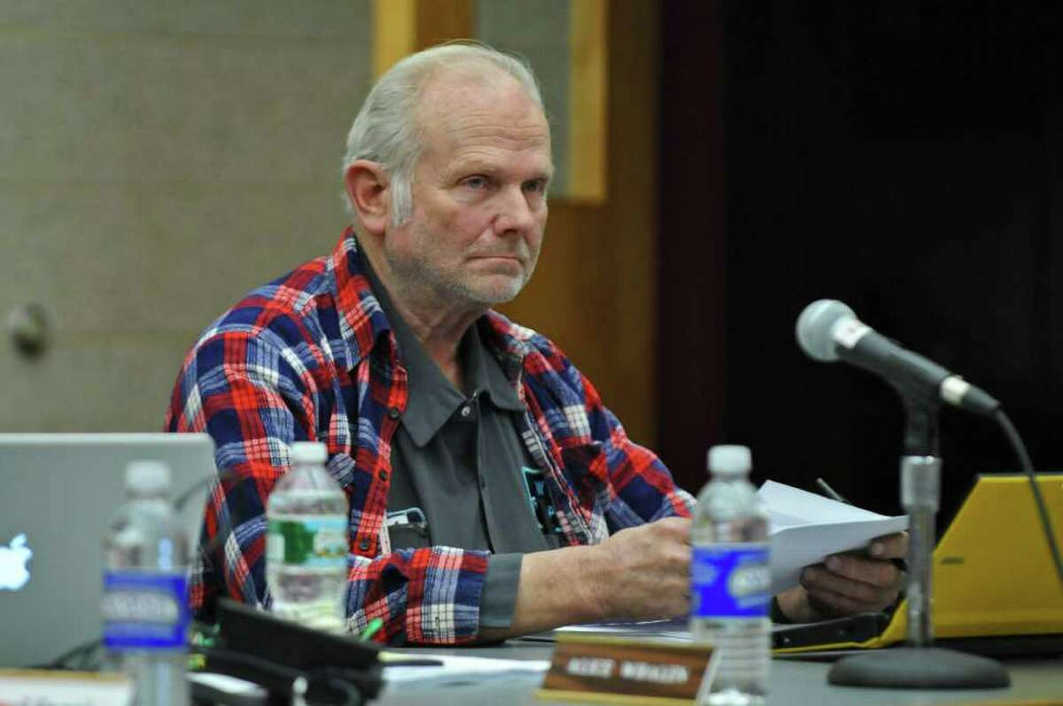 Ravena-Coeymans-Selkirk school board member Rodney Krzykowski listens to a speaker during a board meeting at the high school library on Tuesday night Feb. 28, 2012 in Ravena, N.Y. (Philip Kamrass / Times Union )