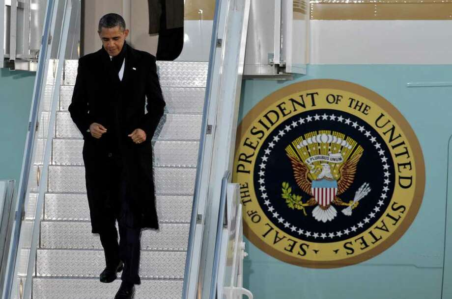 U.S. President Barack Obama arrives to attend the Nuclear Security Summit at Osan Air Base in Osan, south of Seoul, South Korea, Sunday, March 25, 2012.  (AP Photo/Lee Jin-man) Photo: Lee Jin-man / AP