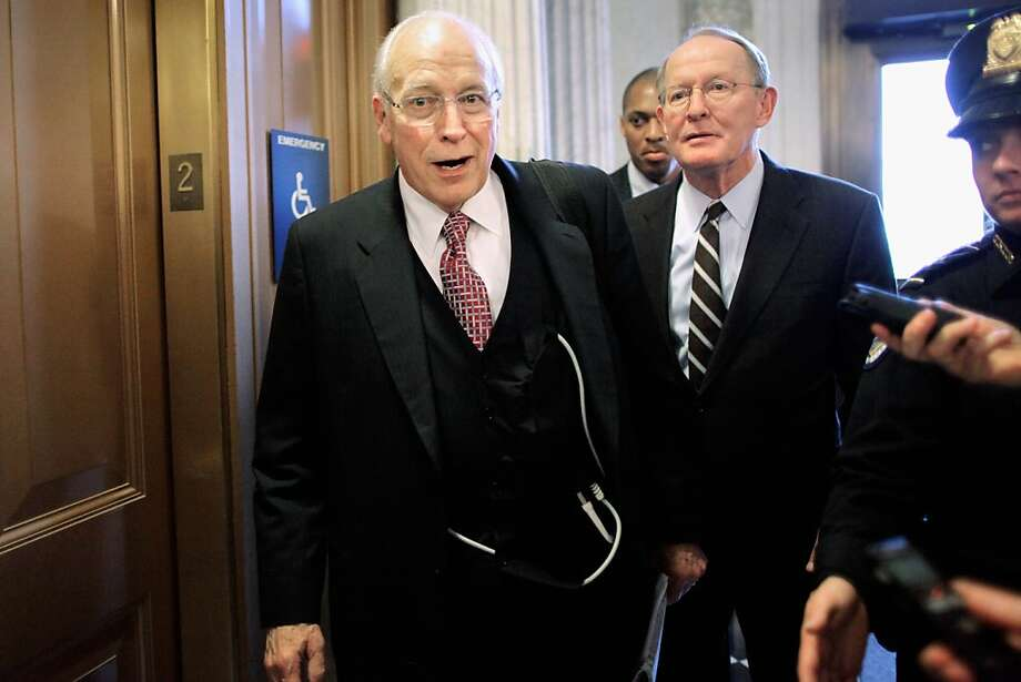 Former U.S. Vice President Dick Cheney (C) refuses to answer press questions as he leaves the Senate Republican policy luncheon with Sen. Lamar Alexander (R-TN) (2nd R) at the U.S. Captiol November 29, 2011 in Washington, DC.  According to his office, former Vice President Dick Cheney received a heart transplant and is now recovering in the intensive care unit of Inova Fairfax Hospital in Falls Church,Virginia. Photo: Chip Somodevilla, Getty Images