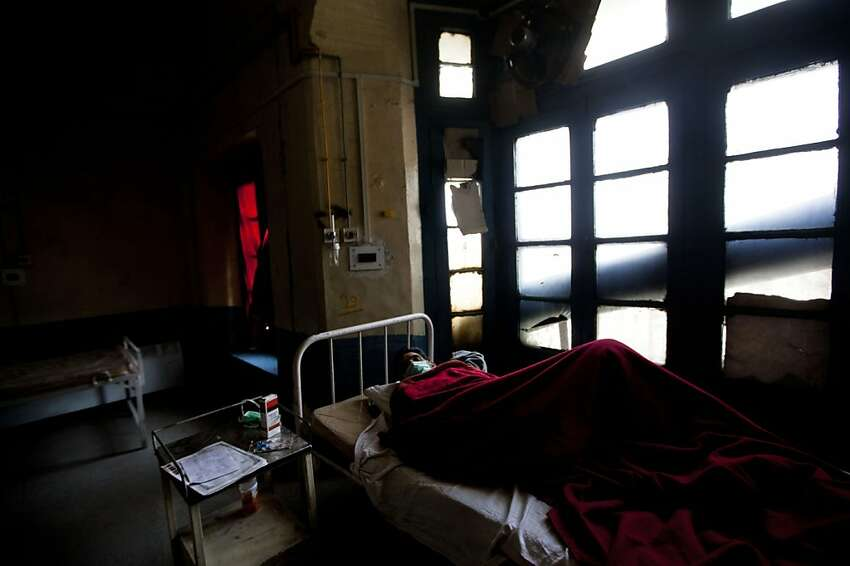 A tuberculosis patient Abdul Rasheed lies on a bed in an isolated ward at the Chest Disease Hospital on World Tuberculosis Day in Srinagar, India, Saturday, March 24, 2012. India's inadequate government-run tuberculosis treatment programs and a lack of regulation of the sale of drugs that fight the disease are responsible for the spiraling number of drug-resistant cases that are difficult to treat, health activists said Friday. India adds an estimated 99,000 cases of drug-resistant TB every year. (AP Photo/ Dar Yasin)
