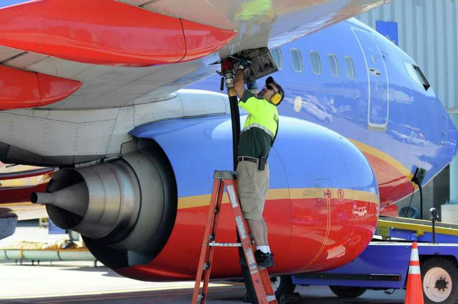 Million Air line service technician Shawn Coons added 3791 gallons of Jet A fuel to a Southwest Airlines jet bound for Las Vegas, before it took off from the Albany International Airport on Wednesday March 21, 2012 in Colonie, N.Y.  (Philip Kamrass / Times Union ) Photo: Philip Kamrass / 00016923A