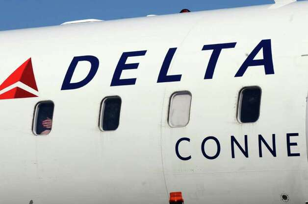 A Delta Connection flight to JFK airport in New York City,  before it took off from the Albany International Airport on Wednesday March 21, 2012 in Colonie, N.Y.  (Philip Kamrass / Times Union ) Photo: Philip Kamrass / 00016923A