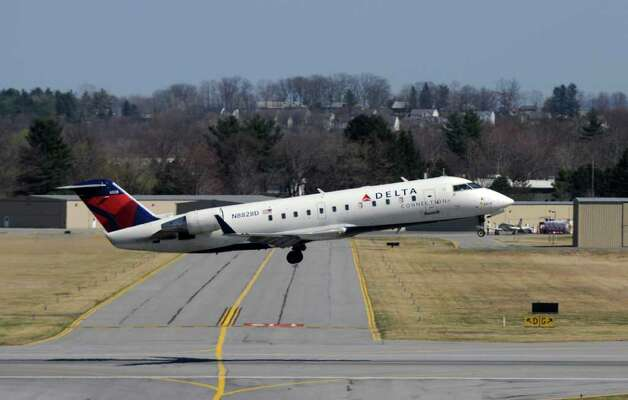 A Delta Connection flight takes off from the Albany International Airport, bound for JFK airport in New York City,   on Wednesday March 21, 2012 in Colonie, N.Y.  (Philip Kamrass / Times Union ) Photo: Philip Kamrass / 00016923A
