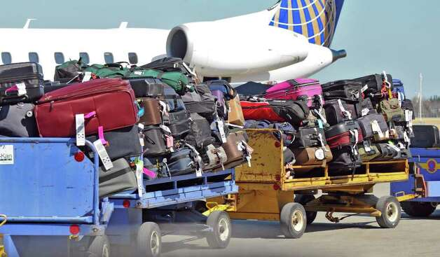 Baggage is driven to a Southwest Airlines jet bound for Las Vegas, before it departed from the Albany International Airport on Wednesday March 21, 2012 in Colonie, N.Y.  (Philip Kamrass / Times Union ) Photo: Philip Kamrass / 00016923A