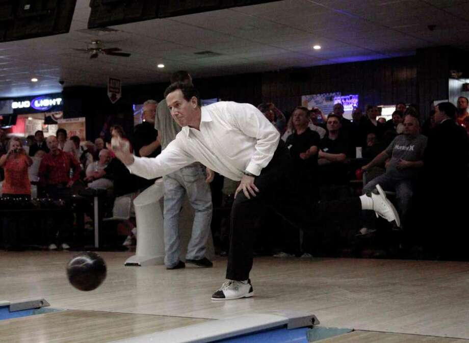 With his win in Louisiana assured, Republican presidential candidate Rick Santorum went bowling for delegates in Wisconsin, site of the next major battleground in the fight for the nomination. Photo: Jae C. Hong / AP